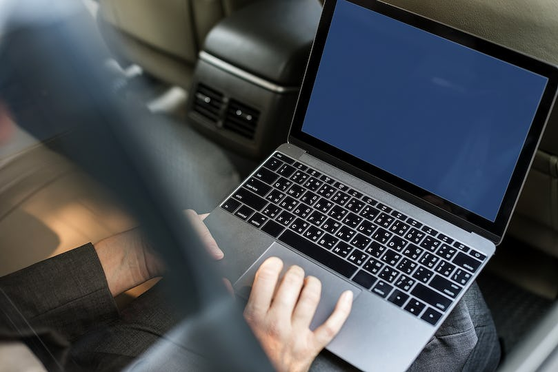 Business People Working Using Laptop Car Inside