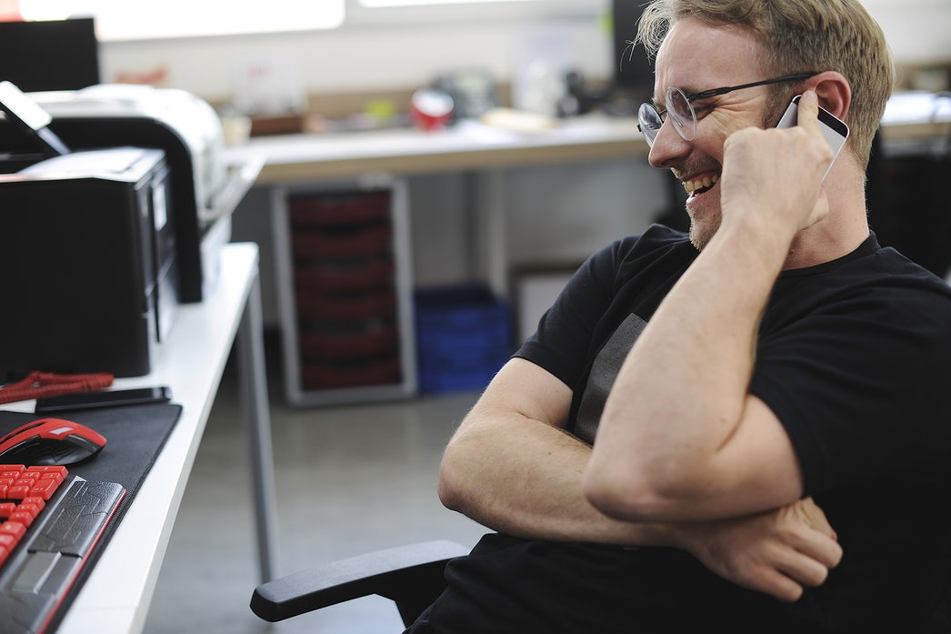 Man Talking on the Phone during Break Time at Office